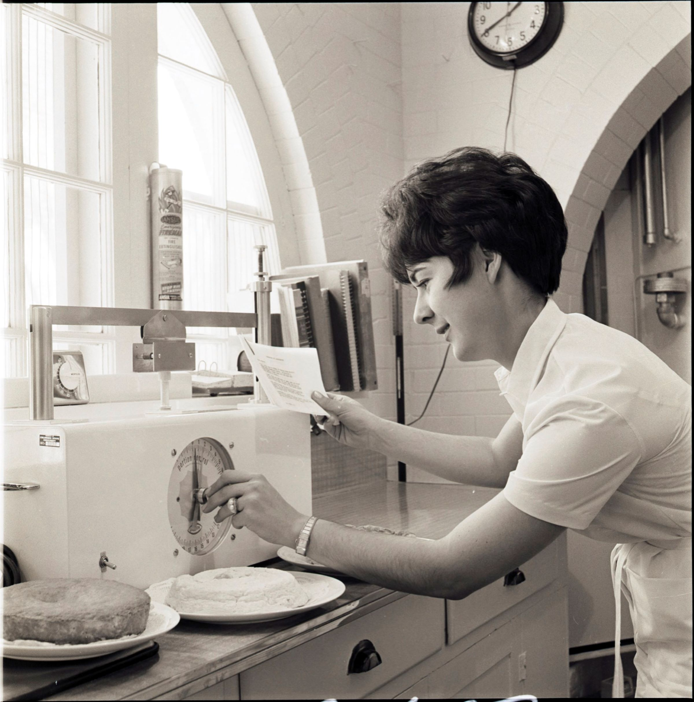 Woman baking in the High Altitude Lab.